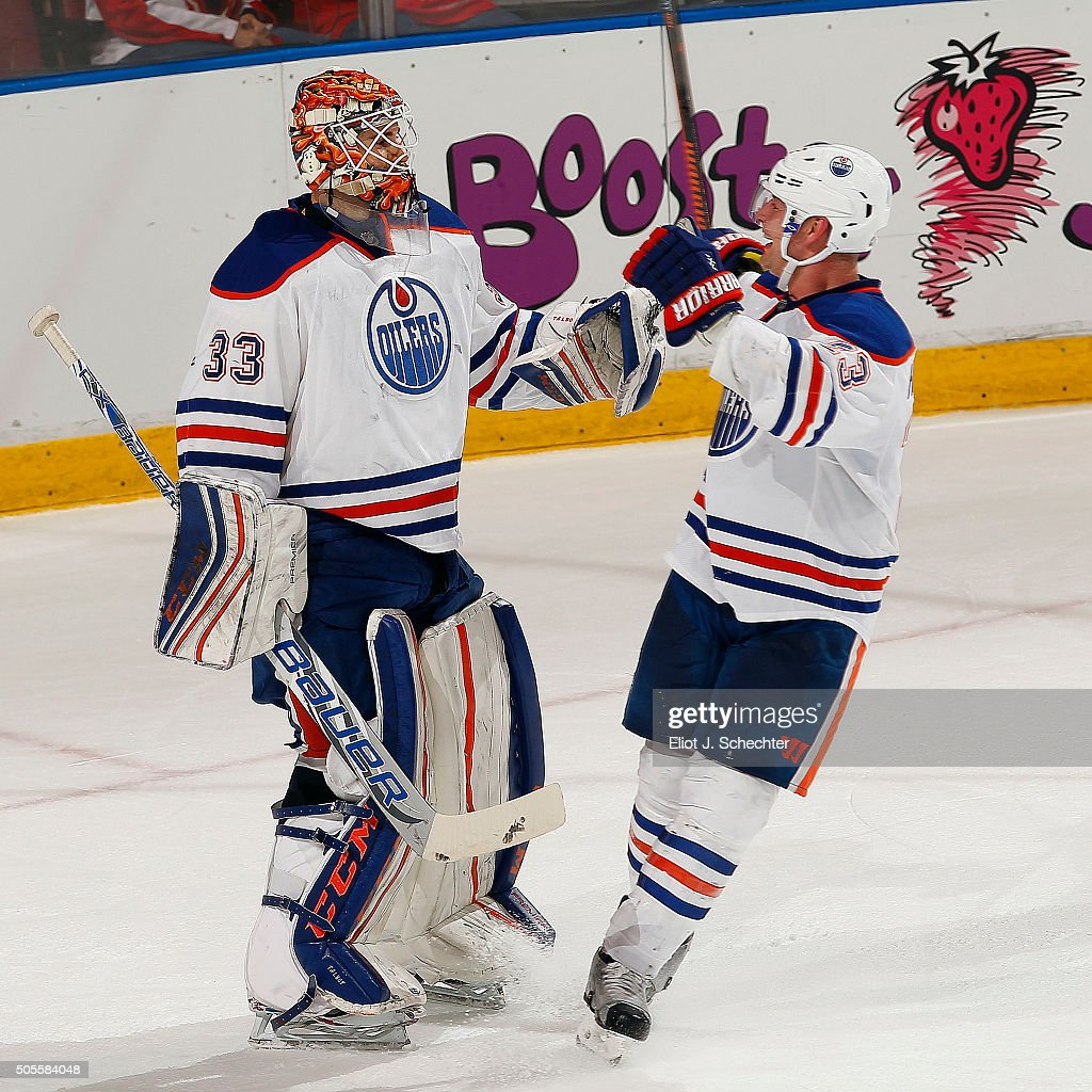 Goaltender Cam Talbot of the Edmonton Oilers celebrates their 42 win with teammate Matt Hendricks against the Florida Panthers at the BBT Center on...
