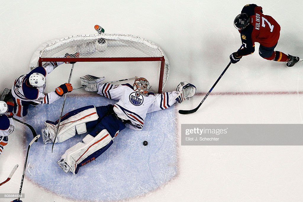 Goaltender Cam Talbot #33 of the Edmonton Oilers defends the net against Dmitry Kulikov #7 of the Florida Panthers at the BB&T Center on January 18, 2016 in Sunrise, Florida.