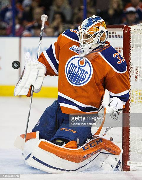 Goaltender Cam Talbot of the Edmonton Oilers makes a save against the Vancouver Canucks on March 18 2016 at Rexall Place in Edmonton Alberta Canada