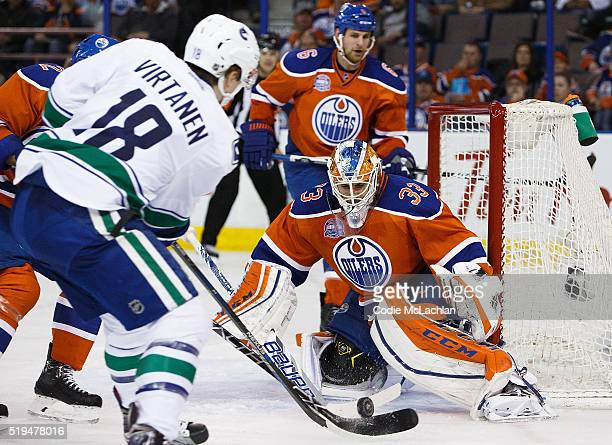 Goaltender Cam Talbot of the Edmonton Oilers makes a save on Jake Virtanen of the Vancouver Canucks on April 6 2016 at Rexall Place in Edmonton...