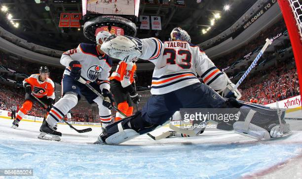 Goaltender Cam Talbot of the Edmonton Oilers slides across his crease as Darnell Nurse defends against Valtteri Filppula and Wayne Simmonds of the...