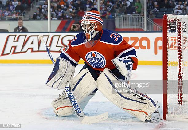 Goaltender Cam Talbot of the Edmonton Oilers waits in the crease during the third period of the 2016 Tim Hortons NHL Heritage Classic against the...