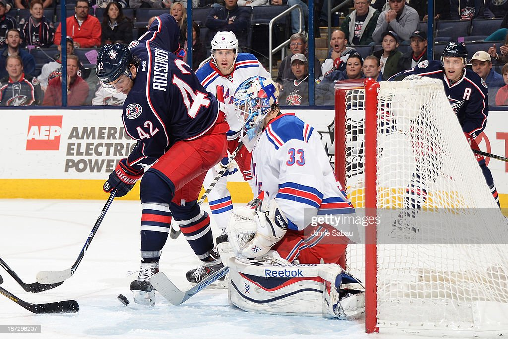 Goaltender <a gi-track='captionPersonalityLinkClicked' href=/galleries/search?phrase=Cam+Talbot&family=editorial&specificpeople=7185126 ng-click='$event.stopPropagation()'>Cam Talbot</a> #33 of the New York Rangers defends the net from <a gi-track='captionPersonalityLinkClicked' href=/galleries/search?phrase=Artem+Anisimov&family=editorial&specificpeople=543215 ng-click='$event.stopPropagation()'>Artem Anisimov</a> #42 of the Columbus Blue Jackets during the third period on November 7, 2013 at Nationwide Arena in Columbus, Ohio. New York defeated Columbus 4-2.