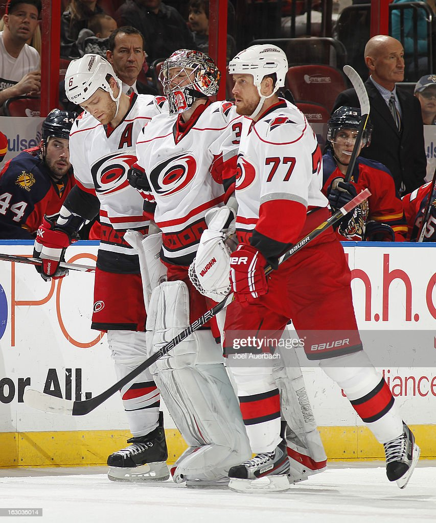 Goaltender Cam Ward #30 is helped off the ice by Joe Corvo #77 and Tim Gleason #6 of the Carolina Hurricanes after being injured in second period action against the Florida Panthers at the BB&T Center on March 3, 2013 in Sunrise, Florida.