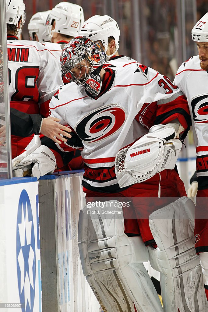 Goaltender Cam Ward #30 of the Carolina Hurricanes is helped off the ice after being injured during the second period against the Florida Panthers at the BB&T Center on March 3, 2013 in Sunrise, Florida.