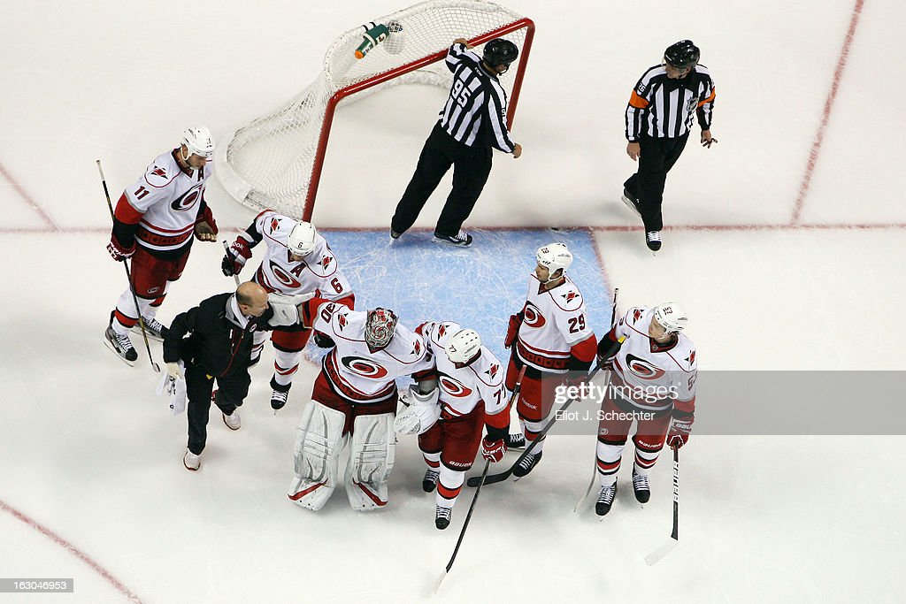 Goaltender <a gi-track='captionPersonalityLinkClicked' href=/galleries/search?phrase=Cam+Ward&family=editorial&specificpeople=453216 ng-click='$event.stopPropagation()'>Cam Ward</a> #30 of the Carolina Hurricanes is helped off the ice after being injured during the second period against the Florida Panthers at the BB&T Center on March 3, 2013 in Sunrise, Florida.