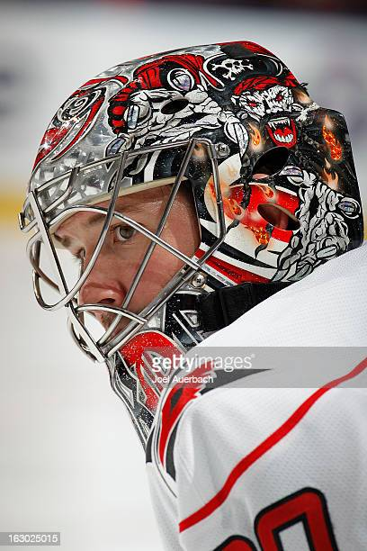 Goaltender Cam Ward of the Carolina Hurricanes looks up ice to watch the Florida Panthers warm up at the BBT Center on March 3 2013 in Sunrise Florida