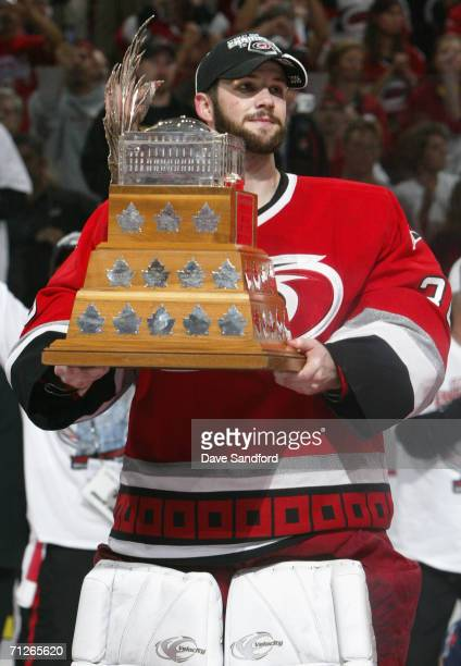 Goaltender Cam Ward of the Carolina Hurricanes poses with the Conn Smythe trophy after defeating the Edmonton Oilers in game seven of the 2006 NHL...