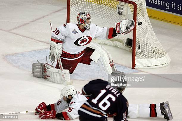 Goaltender Cam Ward of the Carolina Hurricanes protects the goal against Jarret Stoll of the Edmonton Oilers during game six of the 2006 NHL Stanley...