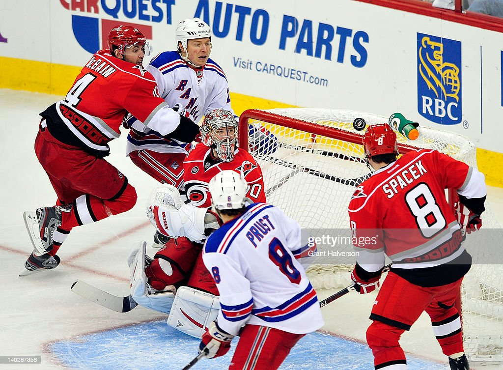 Goaltender <a gi-track='captionPersonalityLinkClicked' href=/galleries/search?phrase=Cam+Ward&family=editorial&specificpeople=453216 ng-click='$event.stopPropagation()'>Cam Ward</a> #30 of the Carolina Hurricanes watches as the puck bounces over the net during play against the New York Rangers at the RBC Center on March 1, 2012 in Raleigh, North Carolina. The Rangers won 3-2.
