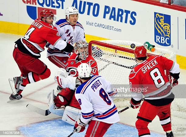 Goaltender Cam Ward of the Carolina Hurricanes watches as the puck bounces over the net during play against the New York Rangers at the RBC Center on...
