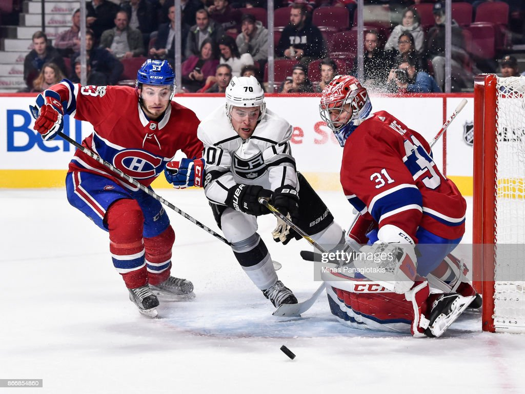 Goaltender Carey Price #31 defends his net as Victor Mete #53 of the Montreal Canadiens and Tanner Pearson #70 of the Los Angeles Kings go after the puck during the NHL game at the Bell Centre on October 26, 2017 in Montreal, Quebec, Canada. The Los Angeles Kings defeated the Montreal Canadiens 4-0.