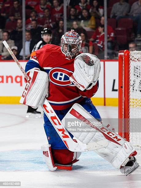 Goaltender Carey Price of the Montreal Canadiens comes face to face with the puck during the NHL game against the St Louis Blues at the Bell Centre...