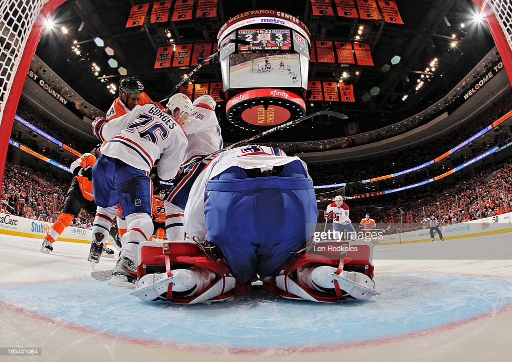 Goaltender <a gi-track='captionPersonalityLinkClicked' href=/galleries/search?phrase=Carey+Price&family=editorial&specificpeople=2222083 ng-click='$event.stopPropagation()'>Carey Price</a> #31 of the Montreal Canadiens covers the puck while teammates <a gi-track='captionPersonalityLinkClicked' href=/galleries/search?phrase=Josh+Gorges&family=editorial&specificpeople=550446 ng-click='$event.stopPropagation()'>Josh Gorges</a> #26 and <a gi-track='captionPersonalityLinkClicked' href=/galleries/search?phrase=P.K.+Subban&family=editorial&specificpeople=714418 ng-click='$event.stopPropagation()'>P.K. Subban</a> #76 defend against <a gi-track='captionPersonalityLinkClicked' href=/galleries/search?phrase=Wayne+Simmonds&family=editorial&specificpeople=4212617 ng-click='$event.stopPropagation()'>Wayne Simmonds</a> #17 of the Philadelphia Flyers on April 3, 2013 at the Wells Fargo Center in Philadelphia, Pennsylvania. The Flyers went on to defeat the Canadiens 5-3.