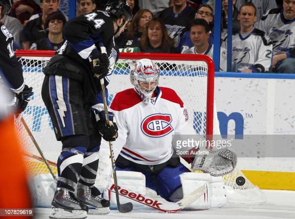 Goaltender Carey Price of the Montreal Canadiens defends against a shot on goal by Nate Thompson of the Tampa Bay Lightning at the St Pete Times...