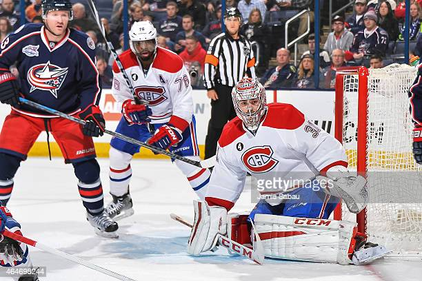 Goaltender Carey Price of the Montreal Canadiens defends the net against the Columbus Blue Jackets on February 26 2015 at Nationwide Arena in...