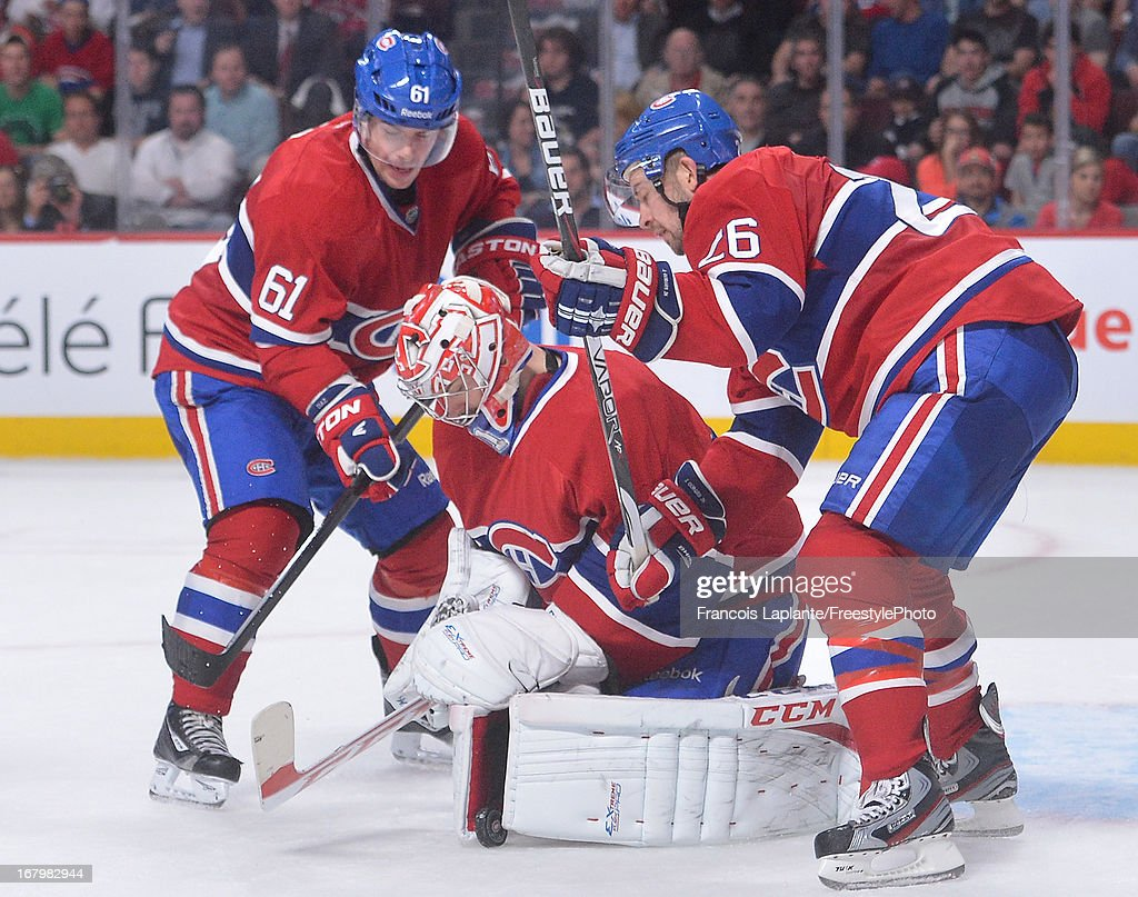 Goaltender <a gi-track='captionPersonalityLinkClicked' href=/galleries/search?phrase=Carey+Price&family=editorial&specificpeople=2222083 ng-click='$event.stopPropagation()'>Carey Price</a> #31 of the Montreal Canadiens freezes the puck against the Ottawa Senators in Game Two of the Eastern Conference Quarterfinals during the 2013 NHL Stanley Cup Playoffs at the Bell Centre on May 3, 2013 in Montreal, Quebec, Canada.
