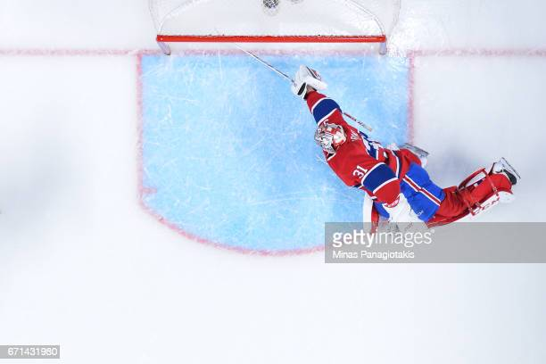 Goaltender Carey Price of the Montreal Canadiens gets the stick out against the New York Rangers in Game Five of the Eastern Conference First Round...