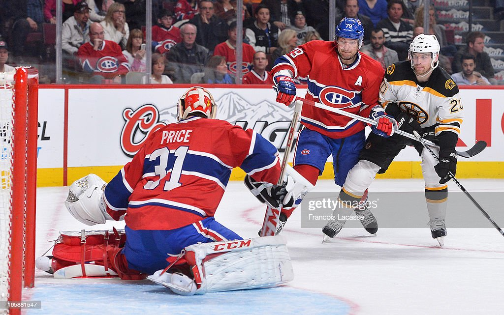 Goaltender <a gi-track='captionPersonalityLinkClicked' href=/galleries/search?phrase=Carey+Price&family=editorial&specificpeople=2222083 ng-click='$event.stopPropagation()'>Carey Price</a> #31 of the Montreal Canadiens kneels on the ice to stop a shot as <a gi-track='captionPersonalityLinkClicked' href=/galleries/search?phrase=Daniel+Paille&family=editorial&specificpeople=706561 ng-click='$event.stopPropagation()'>Daniel Paille</a> #20 of the Boston Bruins battles for position with <a gi-track='captionPersonalityLinkClicked' href=/galleries/search?phrase=Andrei+Markov&family=editorial&specificpeople=204528 ng-click='$event.stopPropagation()'>Andrei Markov</a> #79 during the NHL game on April 6, 2013 at the Bell Centre in Montreal, Quebec, Canada.