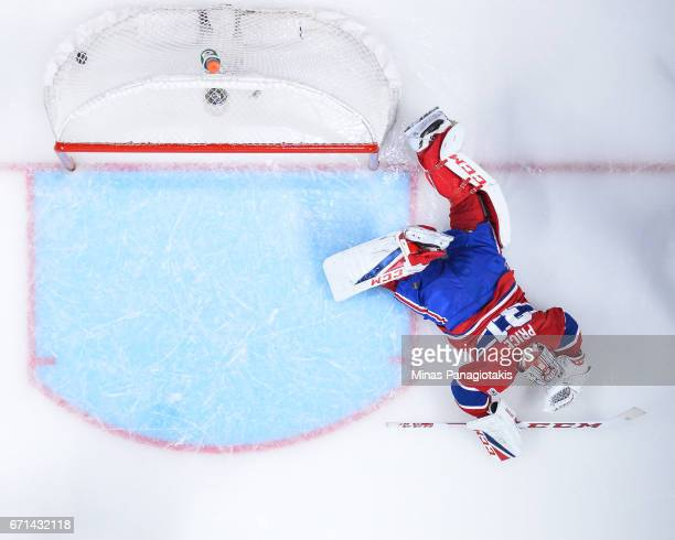 Goaltender Carey Price of the Montreal Canadiens lays on the ice after allowing a goal in overtime against the New York Rangers in Game Five of the...