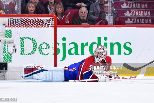 Goaltender Carey Price of the Montreal Canadiens lays on the ice against the New York Rangers in Game Five of the Eastern Conference First Round...