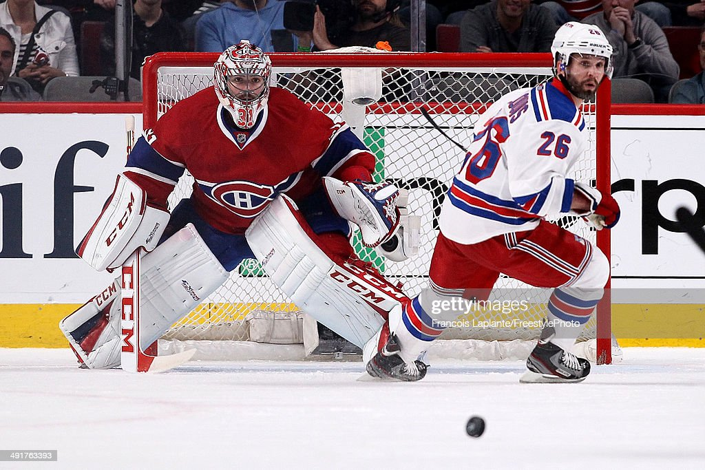 Goaltender Carey Price #31 of the Montreal Canadiens looks at the puck alongside Martin St. Louis #26 of the New York Rangers in the first period in Game One of the Eastern Conference Finals of the 2014 NHL Stanley Cup Playoffs at the Bell Centre on May 17, 2014 in Montreal, Canada.