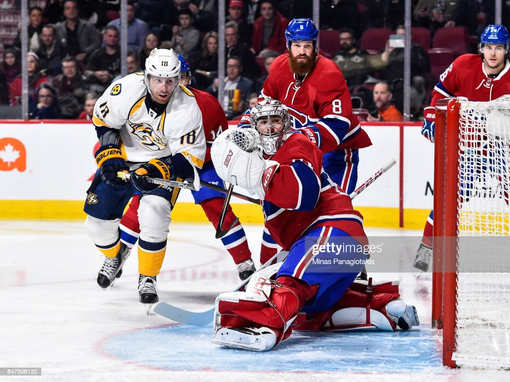 Goaltender Carey Price #31 of the Montreal Canadiens looks behind him as James Neal #18 of the Nashville Predators skates towards him during the NHL game at the Bell Centre on March 2, 2017 in Montreal, Quebec, Canada. The Montreal Canadiens defeated the Nashville Predators 2-1.