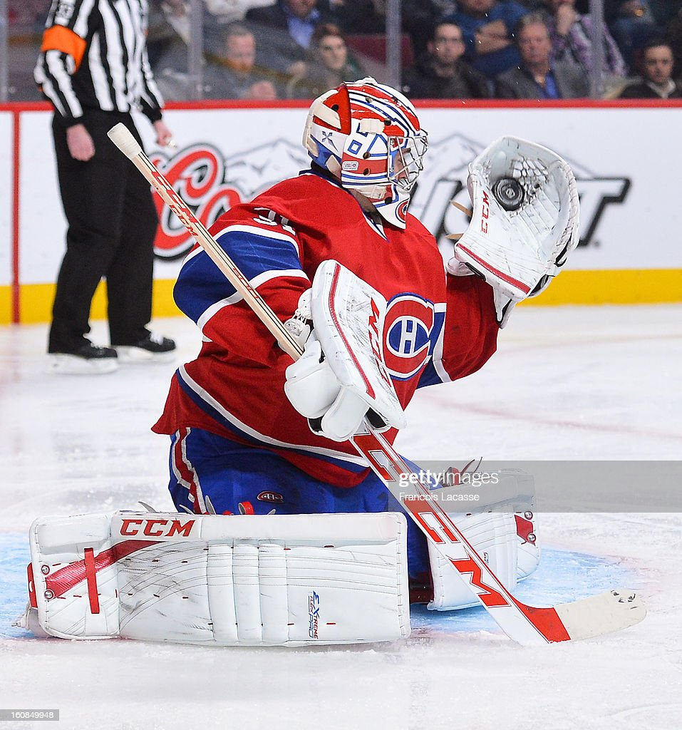 Goaltender <a gi-track='captionPersonalityLinkClicked' href=/galleries/search?phrase=Carey+Price&family=editorial&specificpeople=2222083 ng-click='$event.stopPropagation()'>Carey Price</a> #31 of the Montreal Canadiens makes a glove save during an NHL game against the Boston Bruins on February 6, 2013 at the Bell Centre in Montreal, Quebec, Canada.