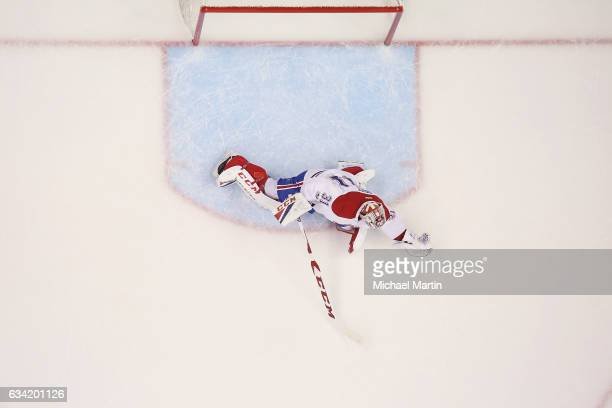 Goaltender Carey Price of the Montreal Canadiens makes a glove save against the Colorado Avalanche at the Pepsi Center on February 7 2017 in Denver...