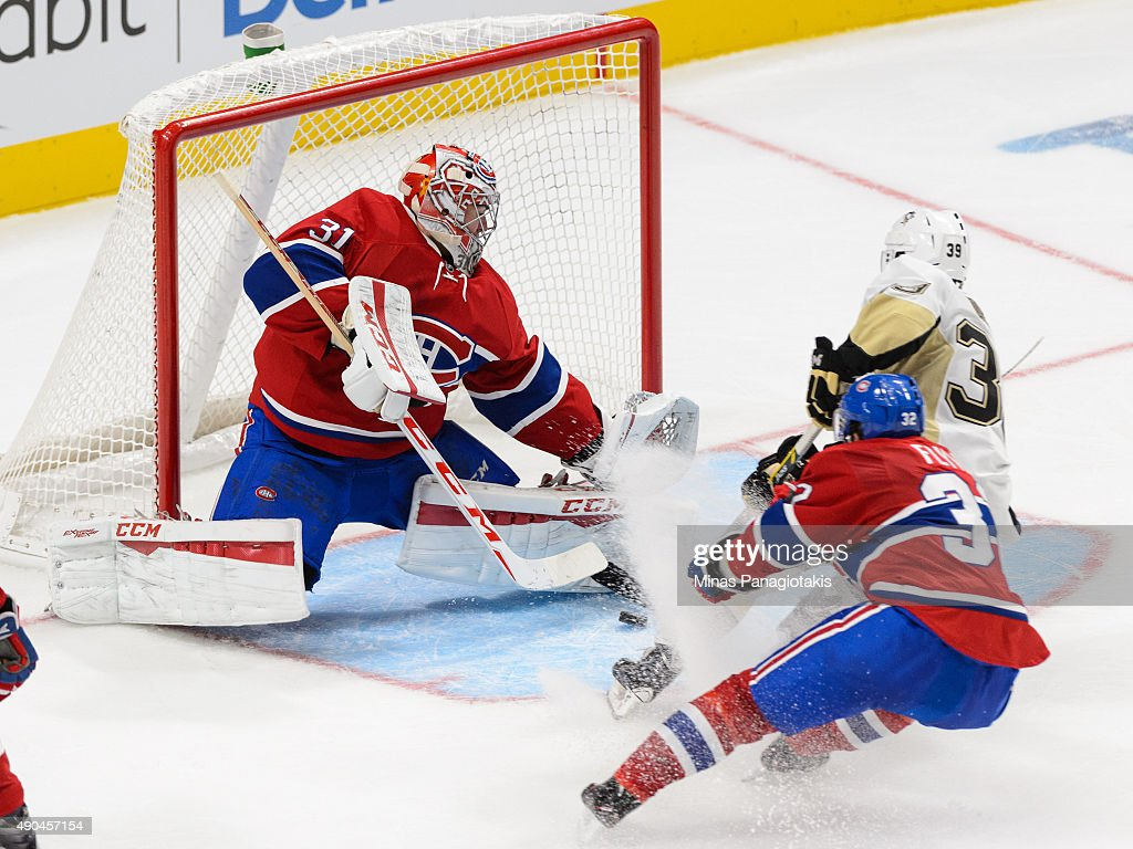 Goaltender Carey Price #31 of the Montreal Canadiens makes a save on Jean-Sabastien Dea #39 of the Pittsburgh Penguins during the NHL pre-season game at the Videotron Centre on September 28, 2015 in Quebec City, Quebec, Canada.