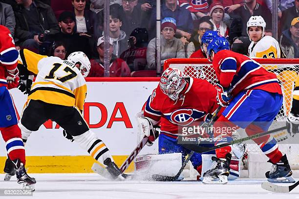 Goaltender Carey Price of the Montreal Canadiens makes a save on Bryan Rust of the Pittsburgh Penguins during the NHL game at the Bell Centre on...