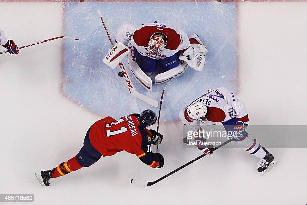 Goaltender Carey Price of the Montreal Canadiens stops a shot by Jonathan Huberdeau of the Florida Panthers at the BBT Center on April 5 2015 in...