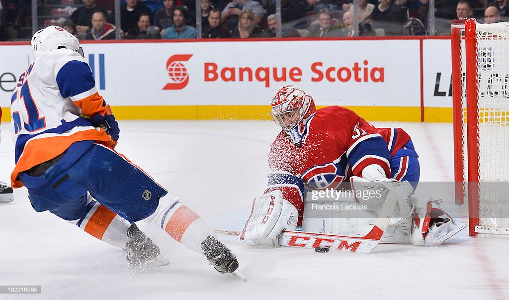 Goaltender Carey Price #31 of the Montreal Canadiens stops a shot from Frans Nielsen #51 of the New York Islanders during the NHL game on February 21, 2013 at the Bell Centre in Montreal, Quebec, Canada.