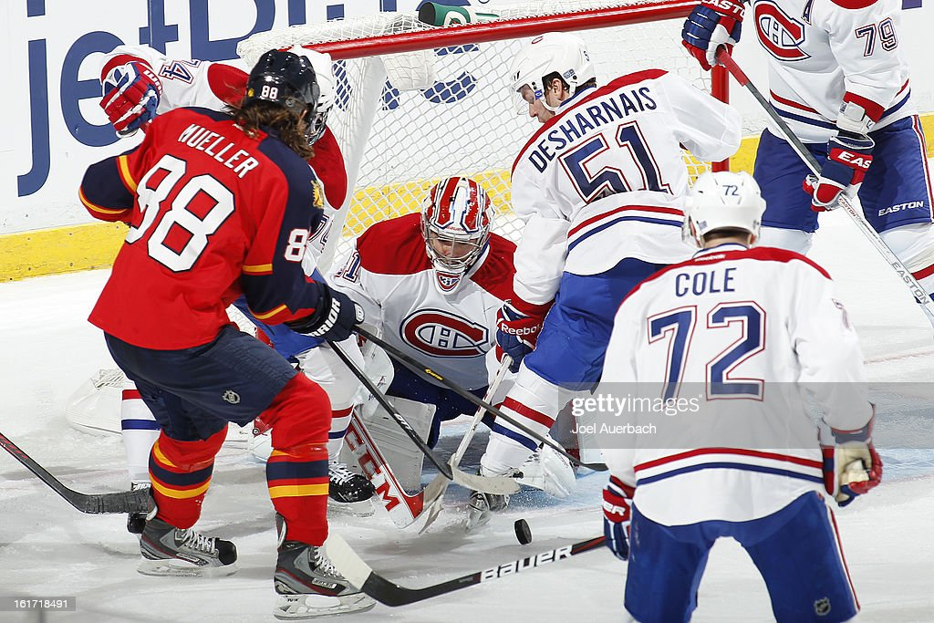 Goaltender <a gi-track='captionPersonalityLinkClicked' href=/galleries/search?phrase=Carey+Price&family=editorial&specificpeople=2222083 ng-click='$event.stopPropagation()'>Carey Price</a> #31 of the Montreal Canadiens stops a third-period shot by Peter Mueller #88 of the Florida Panthers at the BB&T Center on February 14, 2013 in Sunrise, Florida. The Canadiens defeated the Panthers 1-0 in overtime.