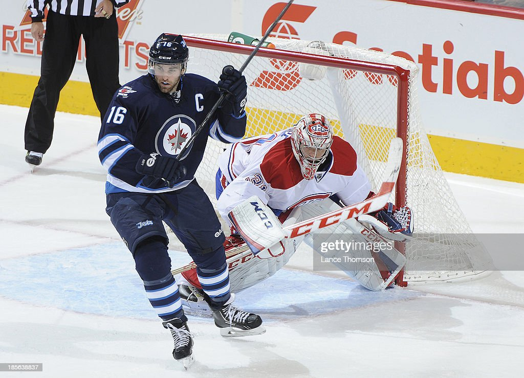 Goaltender <a gi-track='captionPersonalityLinkClicked' href=/galleries/search?phrase=Carey+Price&family=editorial&specificpeople=2222083 ng-click='$event.stopPropagation()'>Carey Price</a> #31 of the Montreal Canadiens tries to look around the screen set by <a gi-track='captionPersonalityLinkClicked' href=/galleries/search?phrase=Andrew+Ladd&family=editorial&specificpeople=228452 ng-click='$event.stopPropagation()'>Andrew Ladd</a> #16 of the Winnipeg Jets during second period action at the MTS Centre on October 15, 2013 in Winnipeg, Manitoba, Canada. The Habs defeated the Jets 3-0.