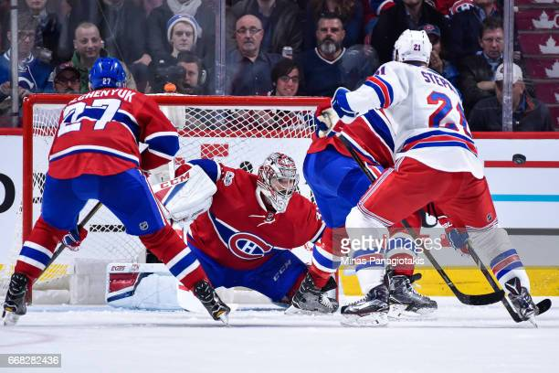 Goaltender Carey Price of the Montreal Canadiens watches for the puck against the New York Rangers in Game One of the Eastern Conference First Round...
