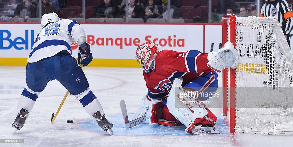 Goaltender <a gi-track='captionPersonalityLinkClicked' href=/galleries/search?phrase=Carey+Price&family=editorial&specificpeople=2222083 ng-click='$event.stopPropagation()'>Carey Price</a> #31of the Montreal Canadiens defends the net against <a gi-track='captionPersonalityLinkClicked' href=/galleries/search?phrase=Martin+St.+Louis&family=editorial&specificpeople=202067 ng-click='$event.stopPropagation()'>Martin St. Louis</a> #26 of the Tampa Bay Lightning in NHL action on April 18, 2013 at the Bell Centre in Montreal, Quebec, Canada.
