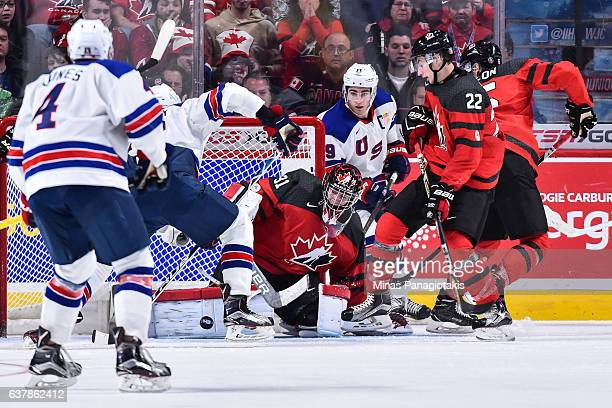 Goaltender Carter Hart of Team Canada makes a pad save during the 2017 IIHF World Junior Championship gold medal game against Team United States at...