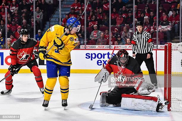 Goaltender Carter Hart of Team Canada makes a pad save on Jonathan Dahlen of Team Sweden during the 2017 IIHF World Junior Championship semifinal...