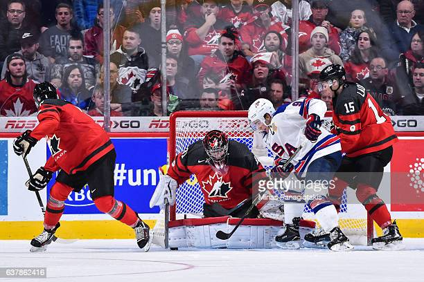 Goaltender Carter Hart of Team Canada makes a save on Luke Kunin of Team United States during the 2017 IIHF World Junior Championship gold medal game...