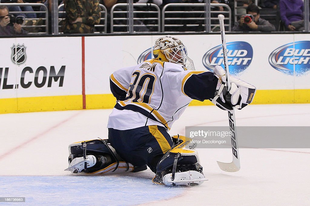 Goaltender <a gi-track='captionPersonalityLinkClicked' href=/galleries/search?phrase=Carter+Hutton&family=editorial&specificpeople=6872781 ng-click='$event.stopPropagation()'>Carter Hutton</a> #30 of the Nashville Predators tries for the blocker pad save during the NHL game against the Los Angeles Kings at Staples Center on November 2, 2013 in Los Angeles, California. The Predators defeated the Kings 4-3.