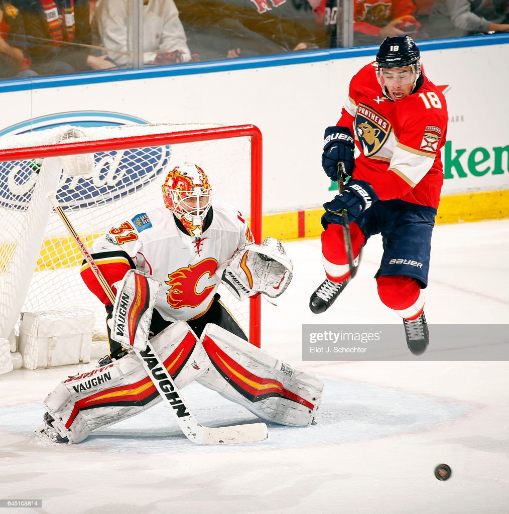 Goaltender Chad Johnson #31 of the Calgary Flames defends the net against Reilly Smith #18 of the Florida Panthers at the BB&T Center on February 24, 2017 in Sunrise, Florida.