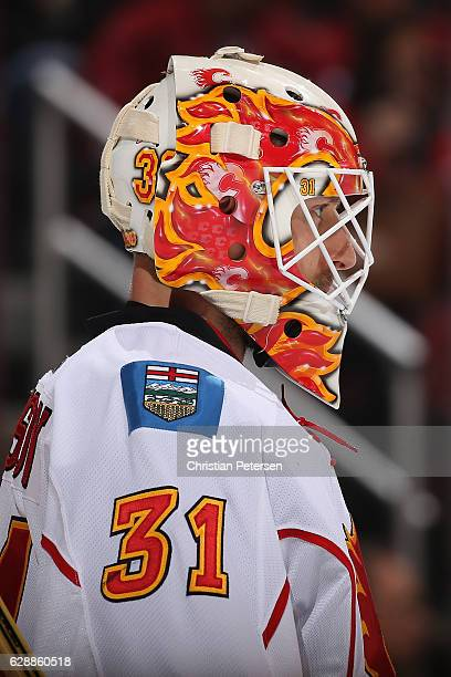 Goaltender Chad Johnson of the Calgary Flames in action during the NHL game against the Arizona Coyotes at Gila River Arena on December 8 2016 in...