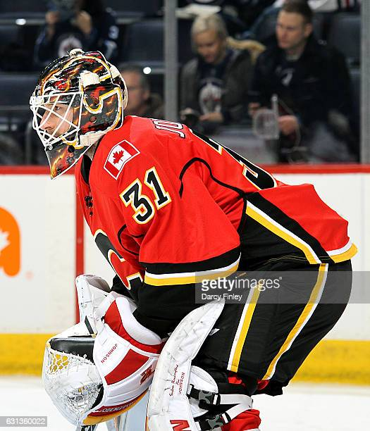 Goaltender Chad Johnson of the Calgary Flames takes part in the pregame warm up prior to NHL action against the Winnipeg Jets at the MTS Centre on...
