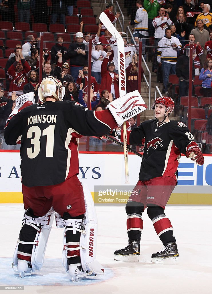 Goaltender Chad Johnson #31 of the Phoenix Coyotes is congratulated by Oliver Ekman-Larsson #23 after a shut out and defeating the Nashville Predators 4-0 in the NHL game at Jobing.com Arena on January 28, 2013 in Glendale, Arizona.