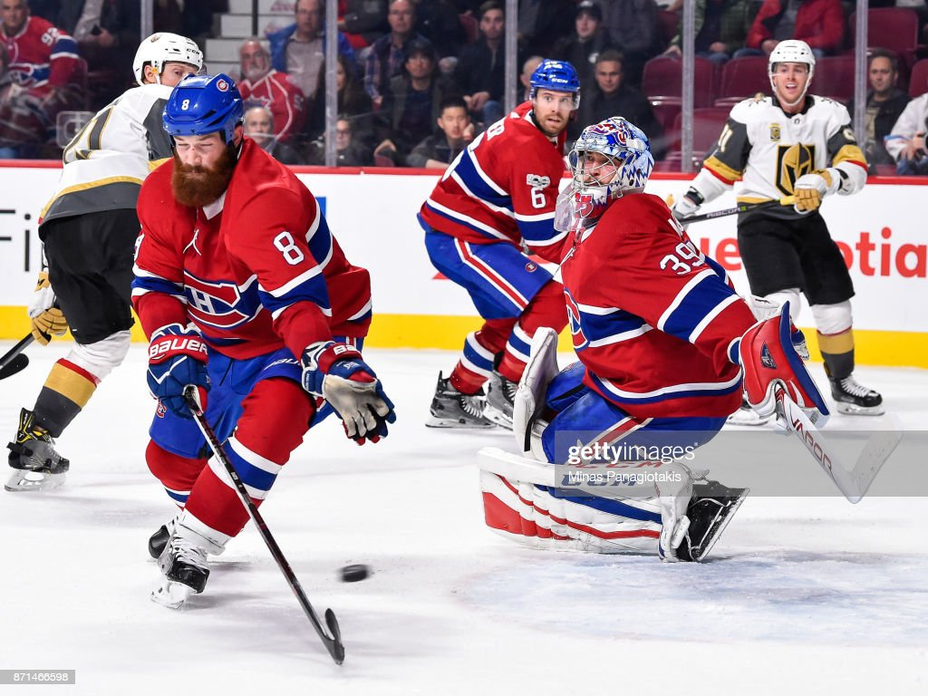 Goaltender Charlie Lindgren #39 is caught off guard as teammate Jordie Benn #8 of the Montreal Canadiens tries to block a shot against the Vegas Golden Knights during the NHL game at the Bell Centre on November 7, 2017 in Montreal, Quebec, Canada. The Montreal Canadiens defeated the Vegas Golden Knights 3-2.