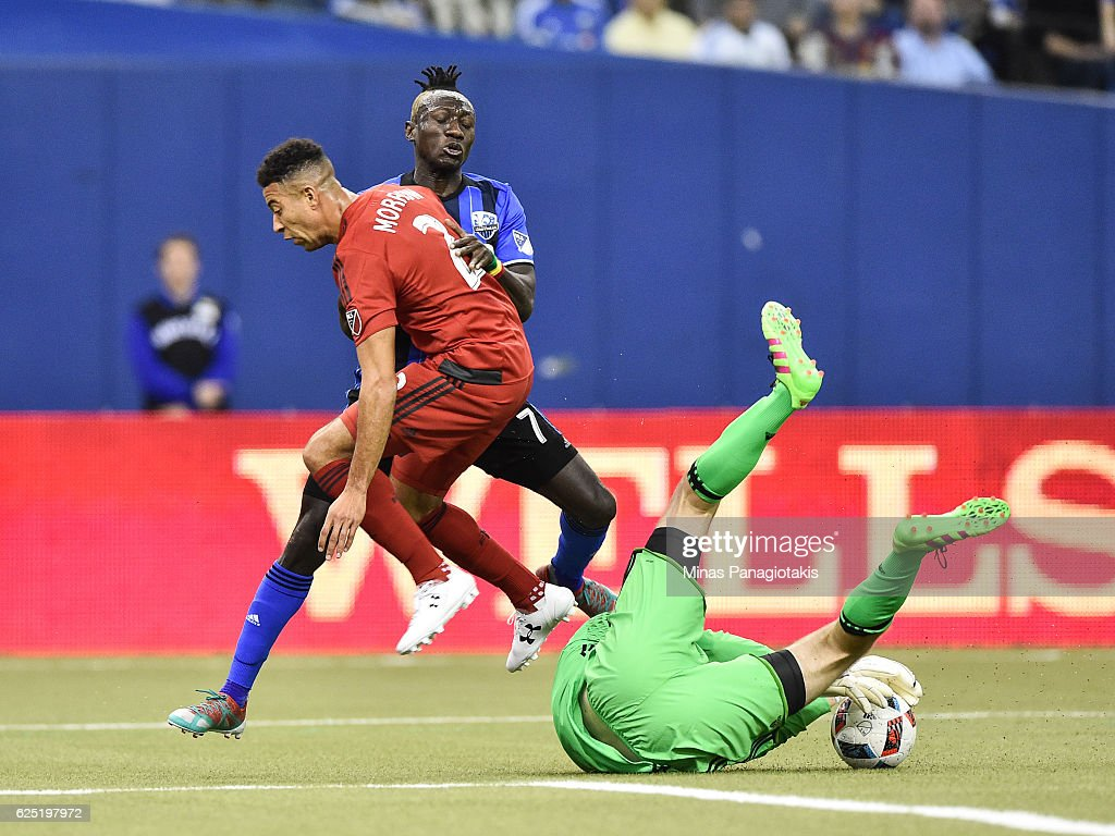 Goaltender Clint Irwin #1 makes a save while Justin Morrow #2 of the Toronto FC defends against Dominic Oduro #7 of the Montreal Impact during leg one of the MLS Eastern Conference finals at Olympic Stadium on November 22, 2016 in Montreal, Quebec, Canada.