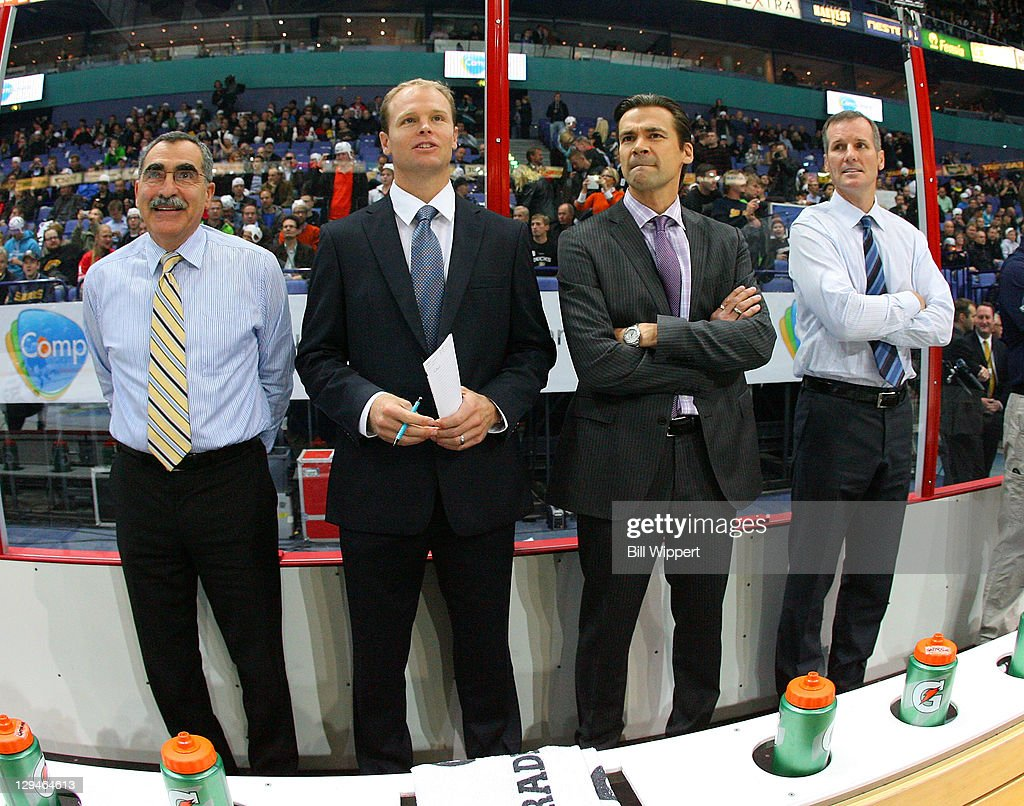 Goaltender coacher Jim Corsi assistant coaches Kevyn Adams Teppo Numminen and James Patrick of the Buffalo Sabres watch warmups before their game...