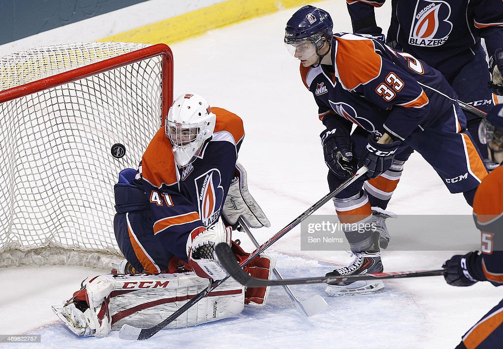 Goaltender Cole Kehler and Austin Douglas of the Kamloops Blazers watches as the puck goes in the net while being scored on by the Vancouver Giants...