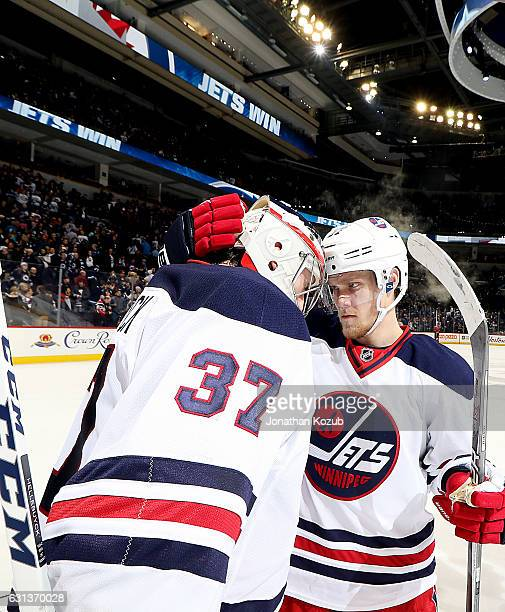 Goaltender Connor Hellebuyck and Nikolaj Ehlers of the Winnipeg Jets celebrate a 20 shutout over the Calgary Flames at the MTS Centre on January 9...